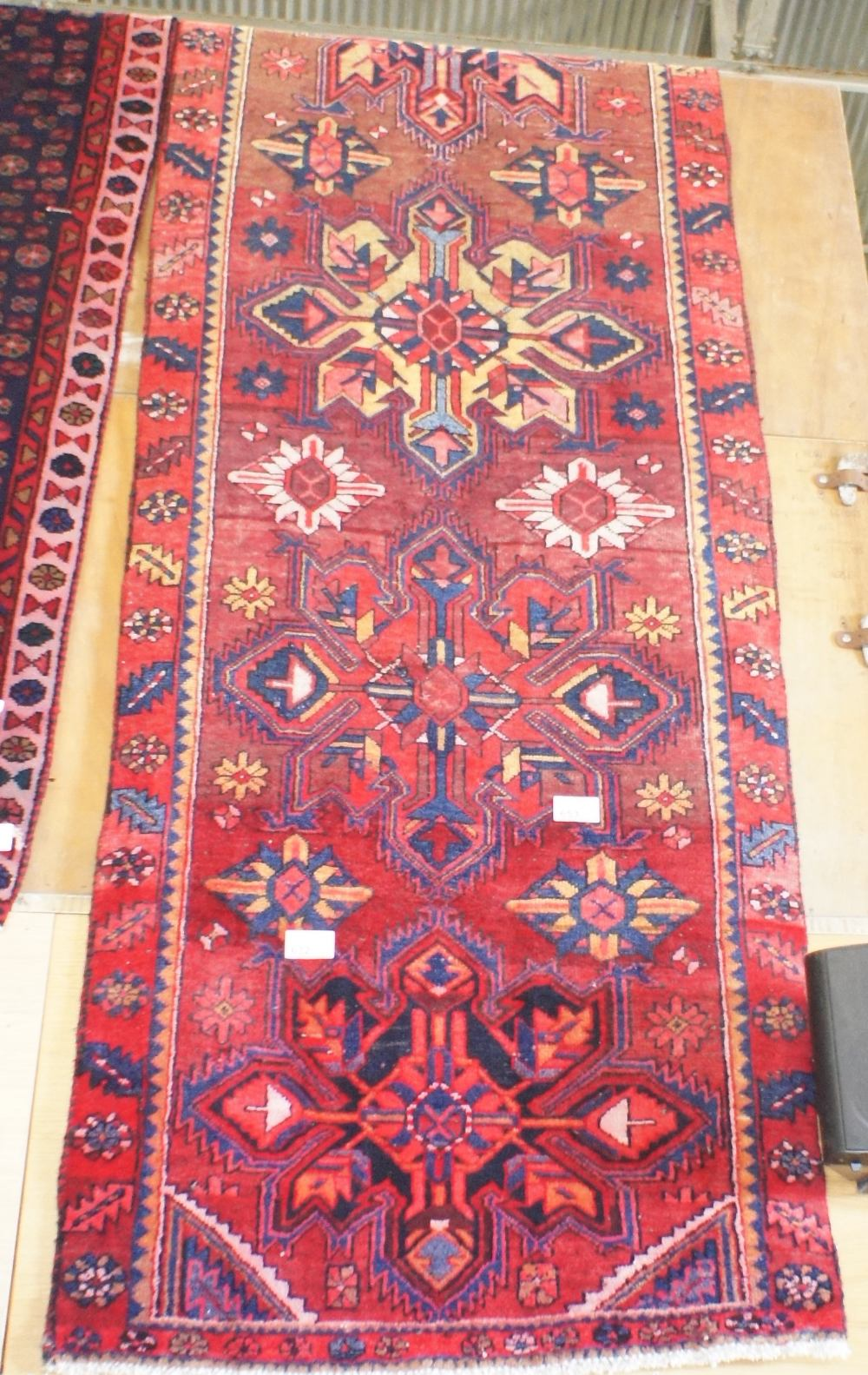 Lot 632 - NV- a hand woven brown ground Persian runner. Approx. 440 X 100cm