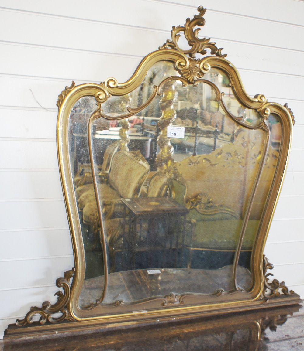 Lot 618 - NV- A large decorative wall mirror with a gilt work frame of scroll work decoration