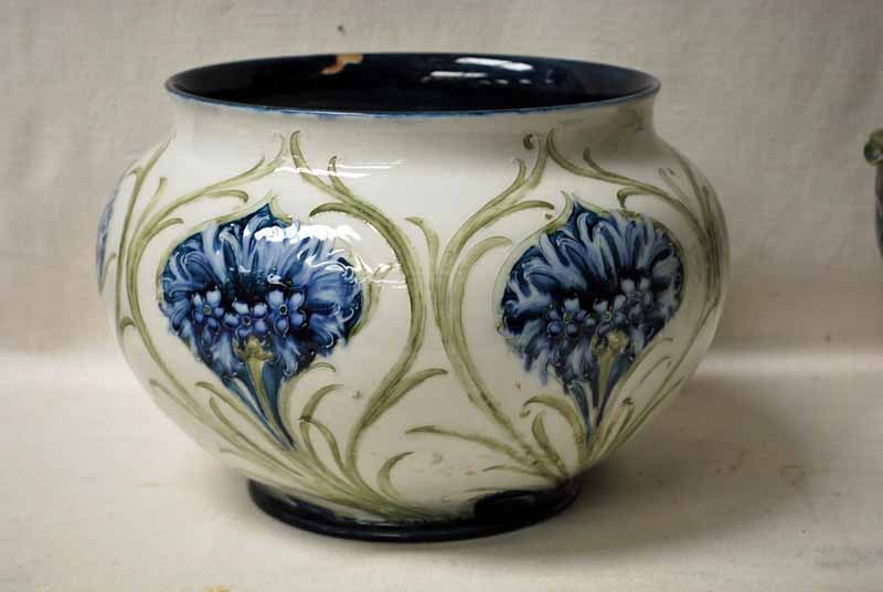 Lot 14 - A late 19th/early 20th century Moorcroft Macintyre Jardiniere of typical compressed circular form