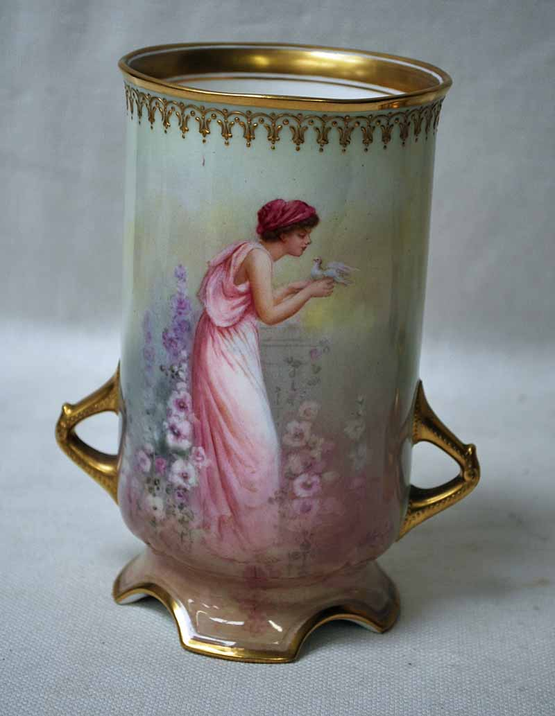 Lot 11 - A Royal Doulton twin-handled Vase of straight sided cylindrical form on four footed base, hand