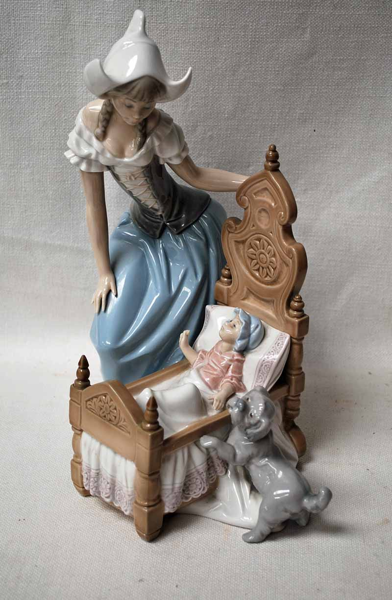 Lot 4 - A large Lladro Figural Group modelled as a young woman and a dog watching a baby in a cot, 30cm high