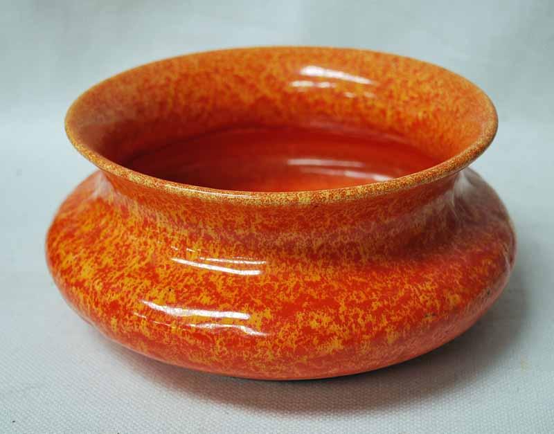 Lot 9 - A Royal Lancastrian orange glaze Bowl, compressed circular form with everted rim, impressed