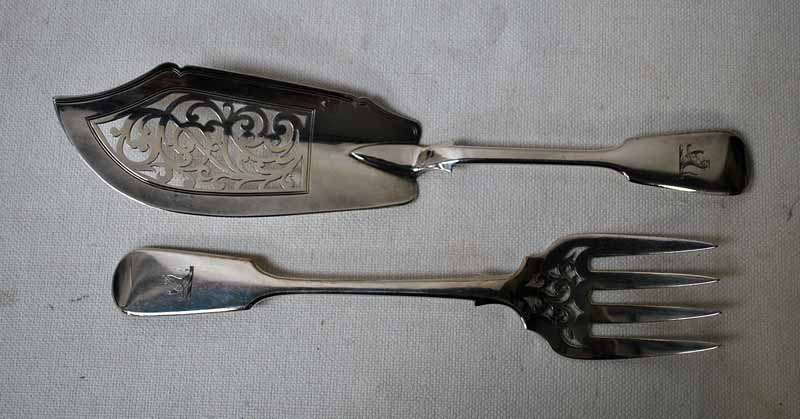 Lot 28 - A pair of Victorian silver Fish Servers, fiddle pattern with pierced scroll work decoration,