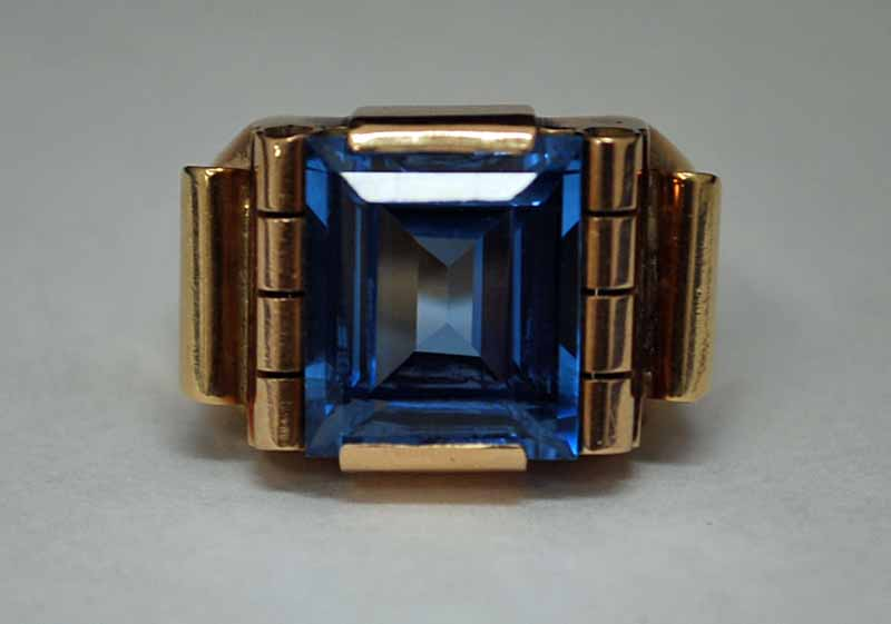 Lot 39 - A Continental Gold and Sapphire Ring, the unmarked shank tests as 18ct, the facetted step cut