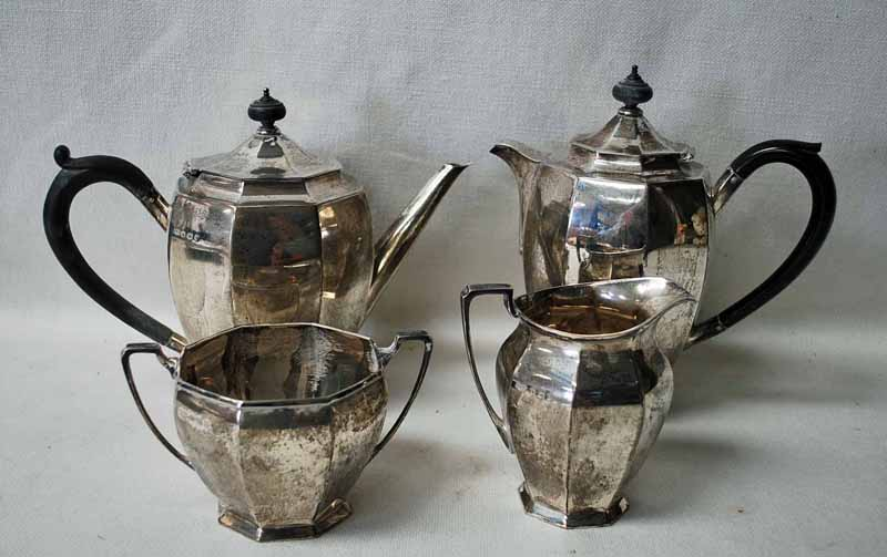 Lot 30 - A George V silver four-piece Coffee Service of curved octagonal form, consisting of a coffee pot and