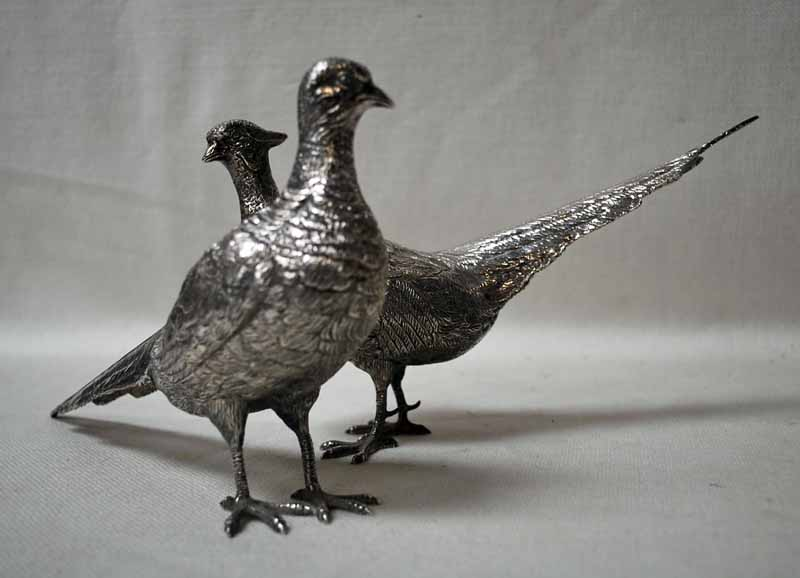 Lot 25 - A mid/late 20th century pair of silver table models of Pheasants, each hallmarked London 1965, 28.