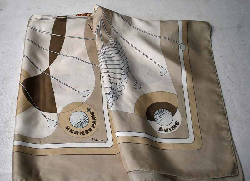 Lot 19 - A Hermes of Paris Silk Scarf in the Swing design by J Abadie, the design featuring Golf Clubs and