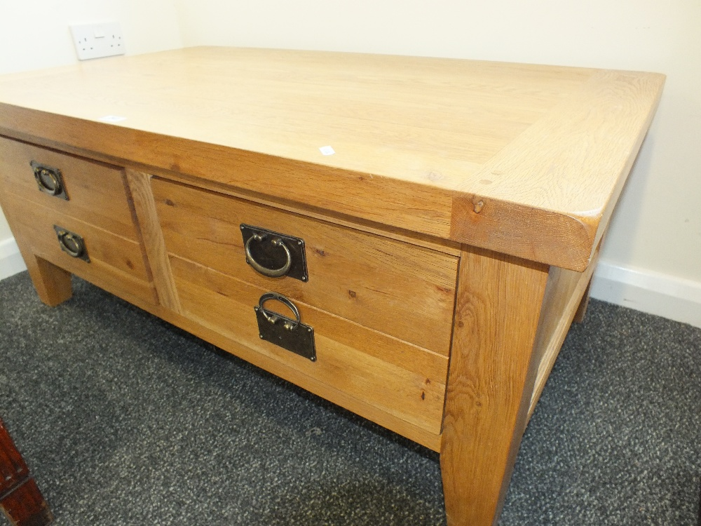A Modern Light Oak Coffee Table With Two Deep Frieze Drawers