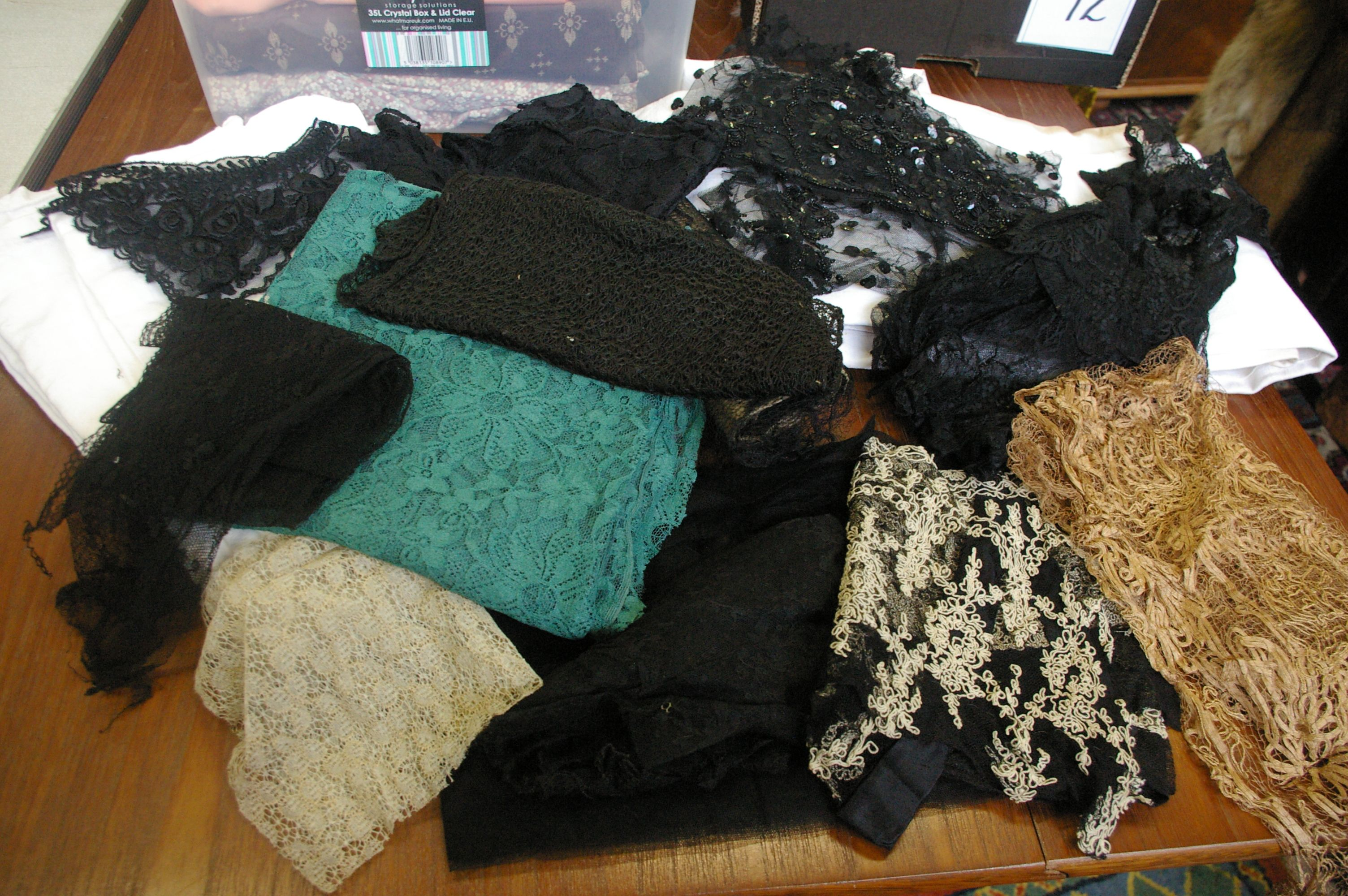 Lot 6 - A quantity of late 19th and early 20th Century lace, hat veiling, green lace off cuts and two French
