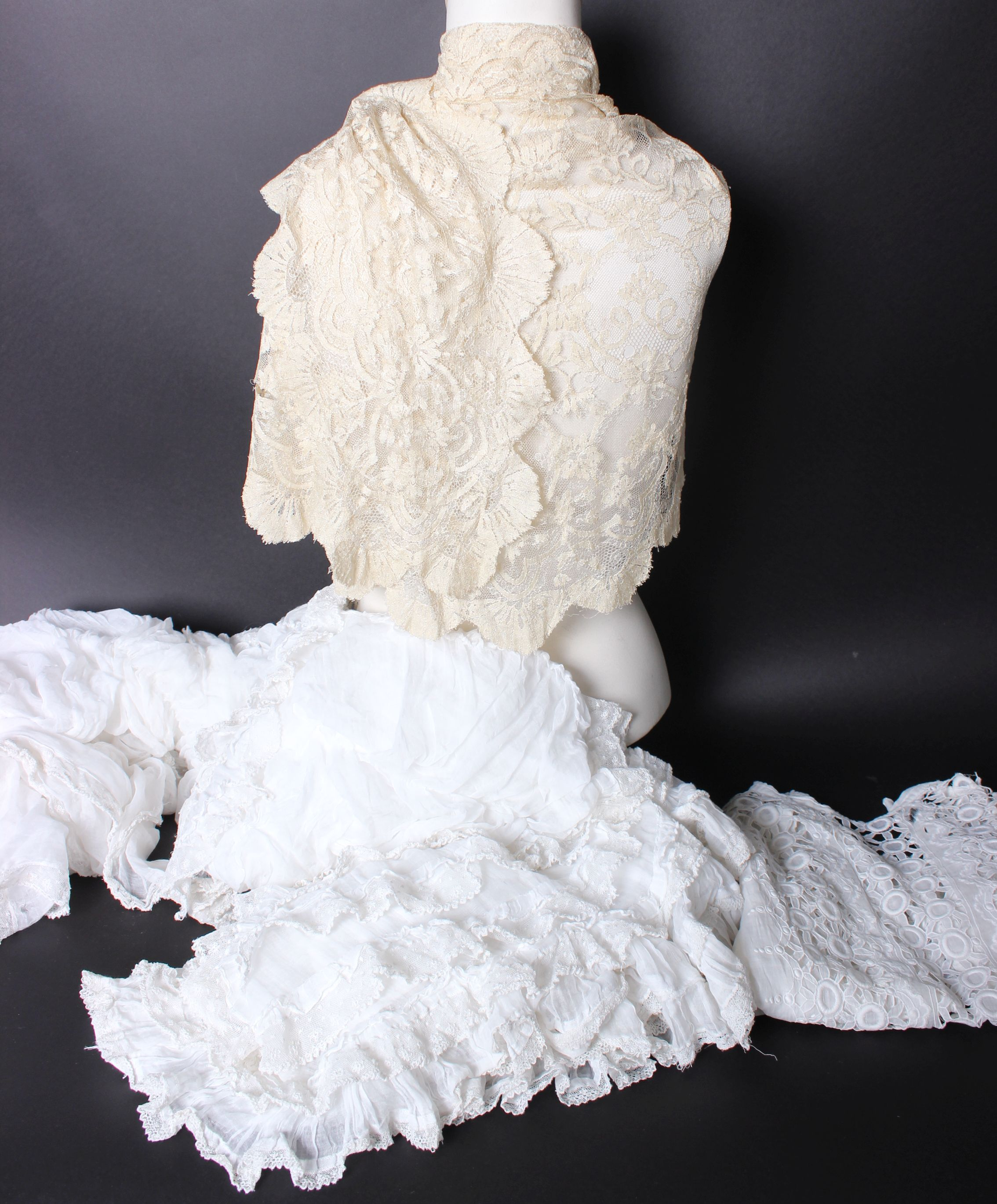 Lot 10 - Two late 19th/early 20th Century cream lace-trimmed children's capes, and a quantity of