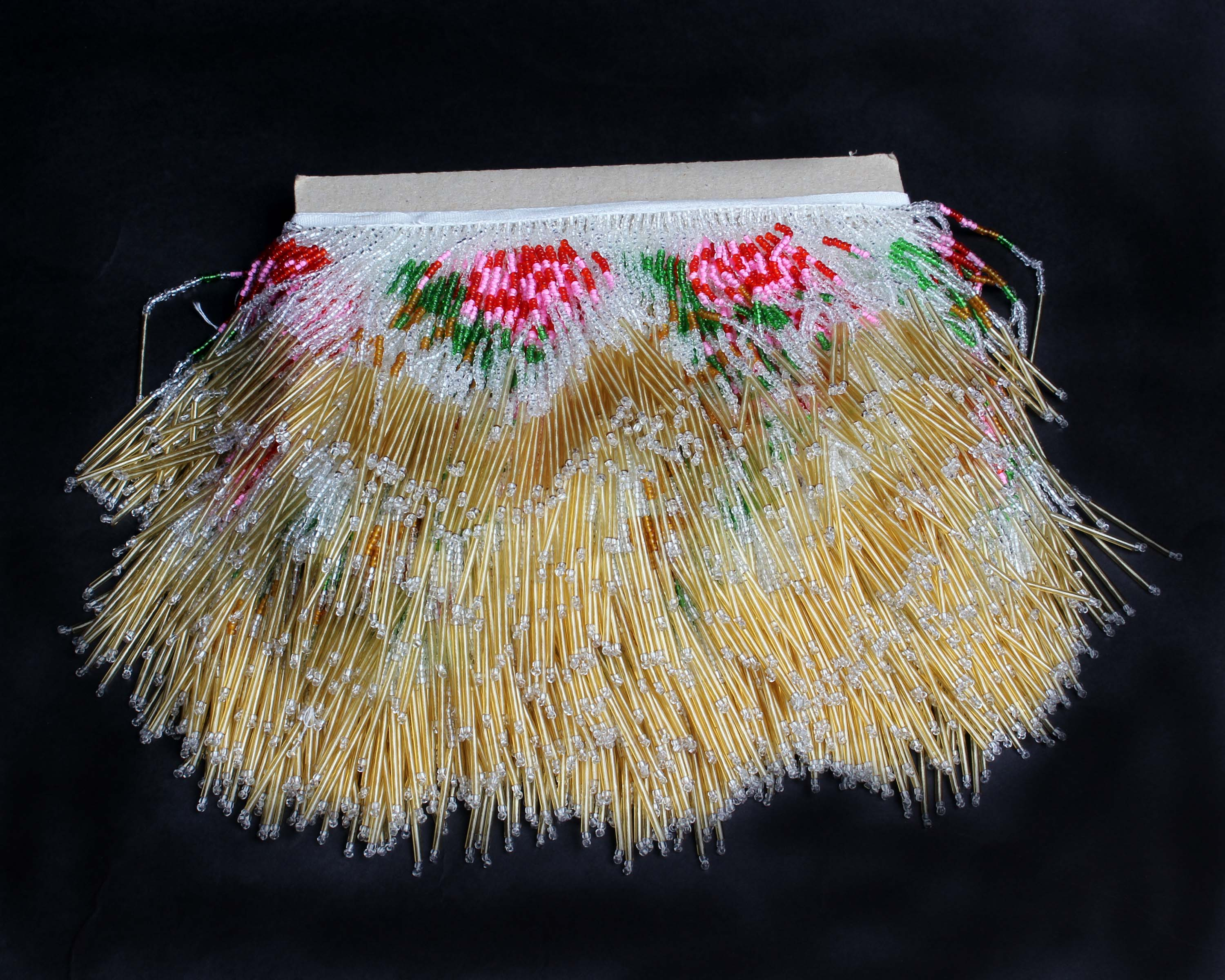 Lot 21 - Five metres of unused 1920s bead trimming, composed of pink, green, white and pale gold coloured