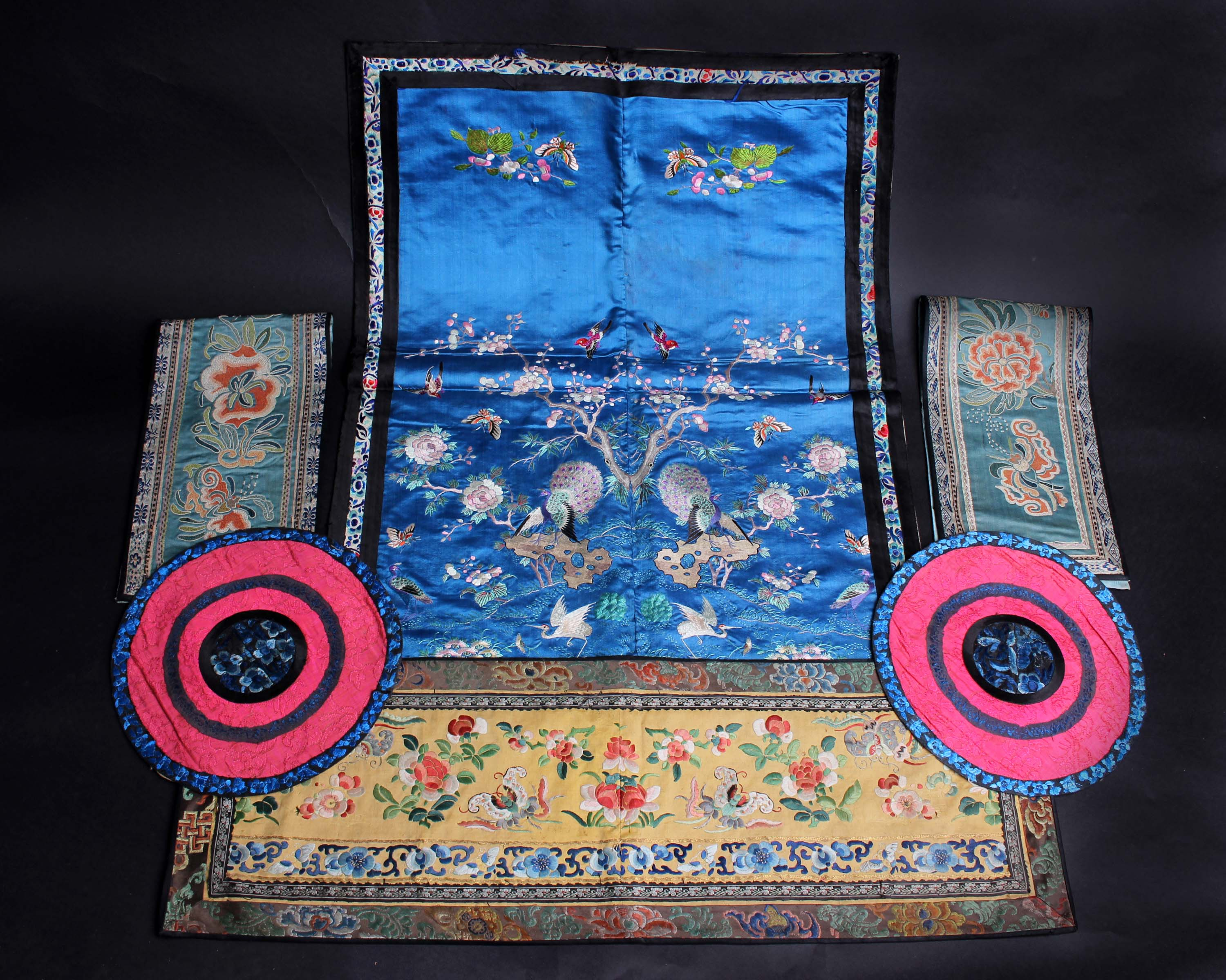 Lot 41 - A panel of early 20th Century Chinese blue silk embroidered with a pair of peacocks, cranes and a
