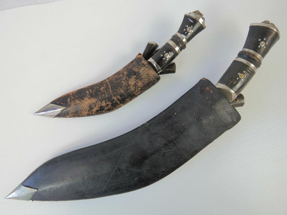 Two Kukri knives with leather sheaths, o