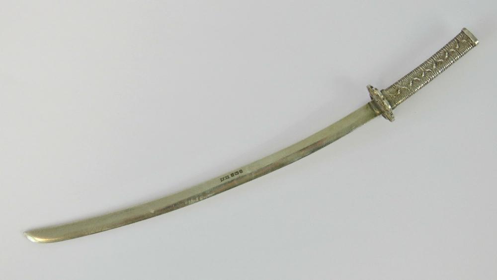 Lot 56 - A HM silver miniature Japanese sword (od