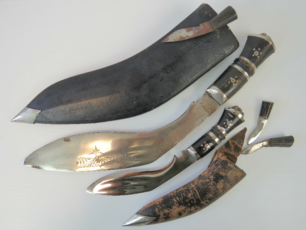 Lot 99 - Two Kukri knives with leather sheaths, o
