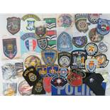 Various cloth police badges including; M