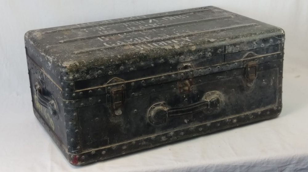 A vintage military travel trunk, lid lif