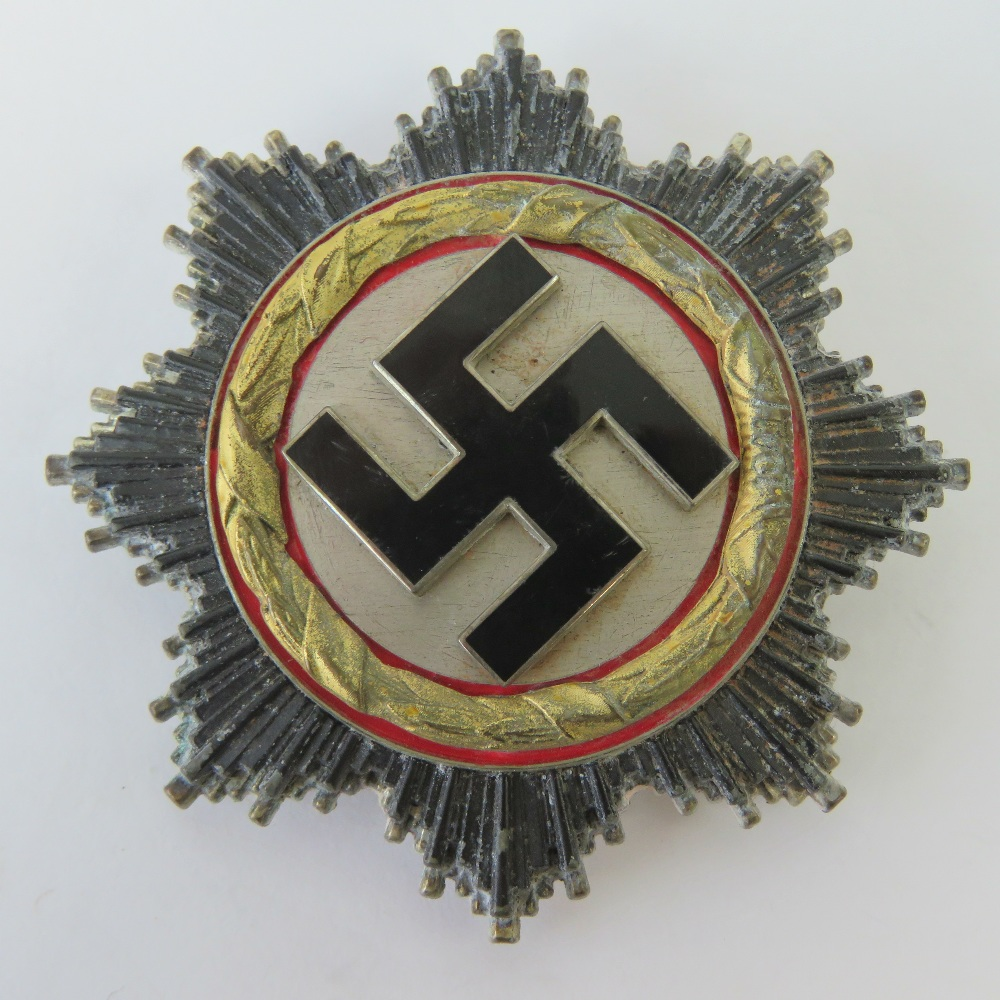 Lot 75 - A WWII 'Gold' German Cross badge, pin st