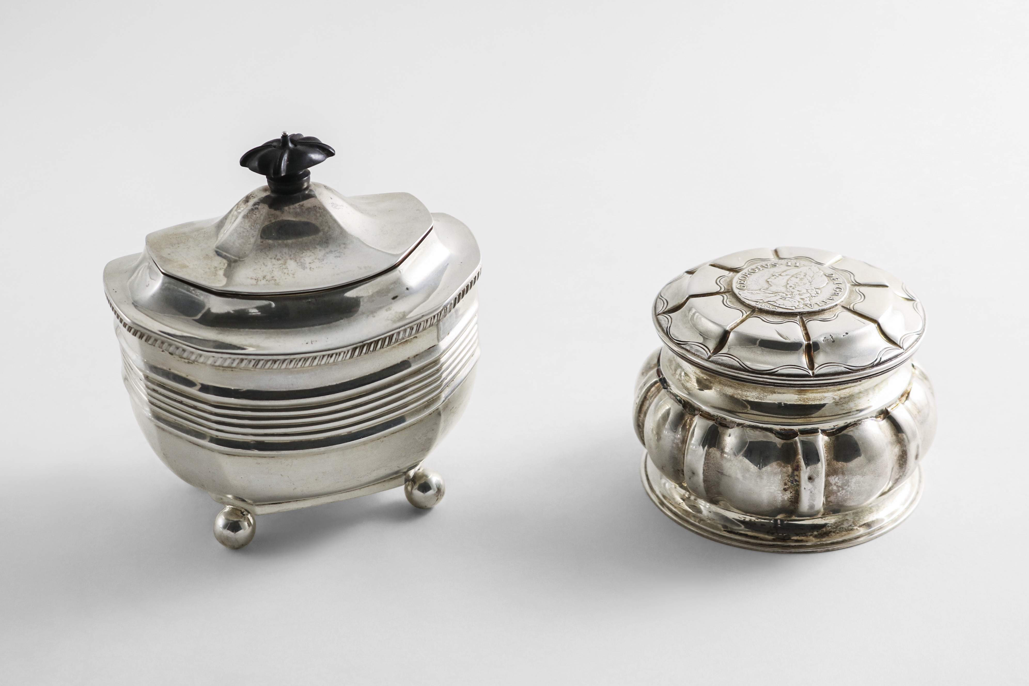 A LATE VICTORIAN SILVER TEA CADDY on ball feet with a domed cover, by T. Bradbury, London 1898 and a