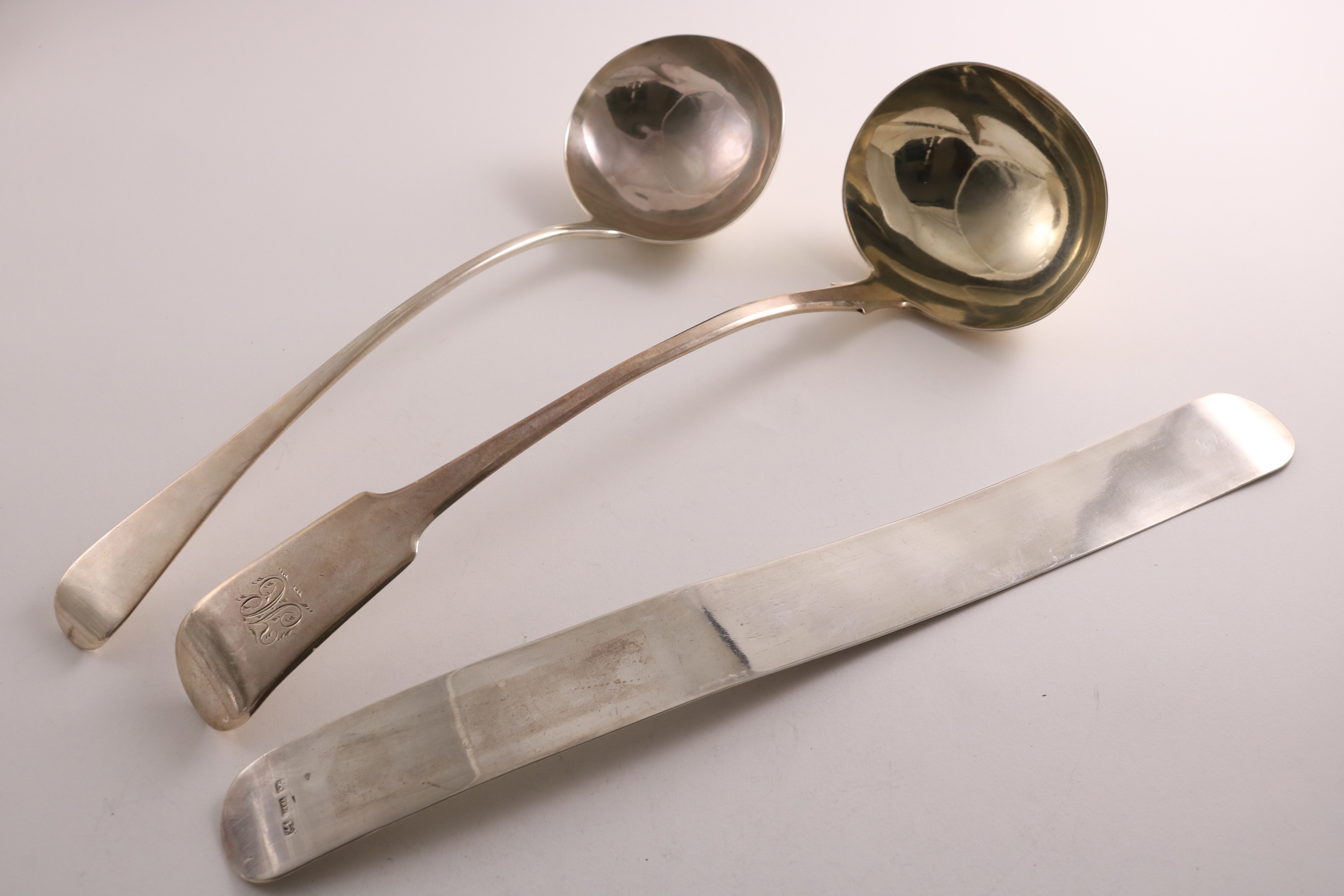 "A GEORGE IV PROVINCIAL SILVER FIDDLE PATTERN SOUP LADLE initialled ""H"", by George Turner, Exeter"