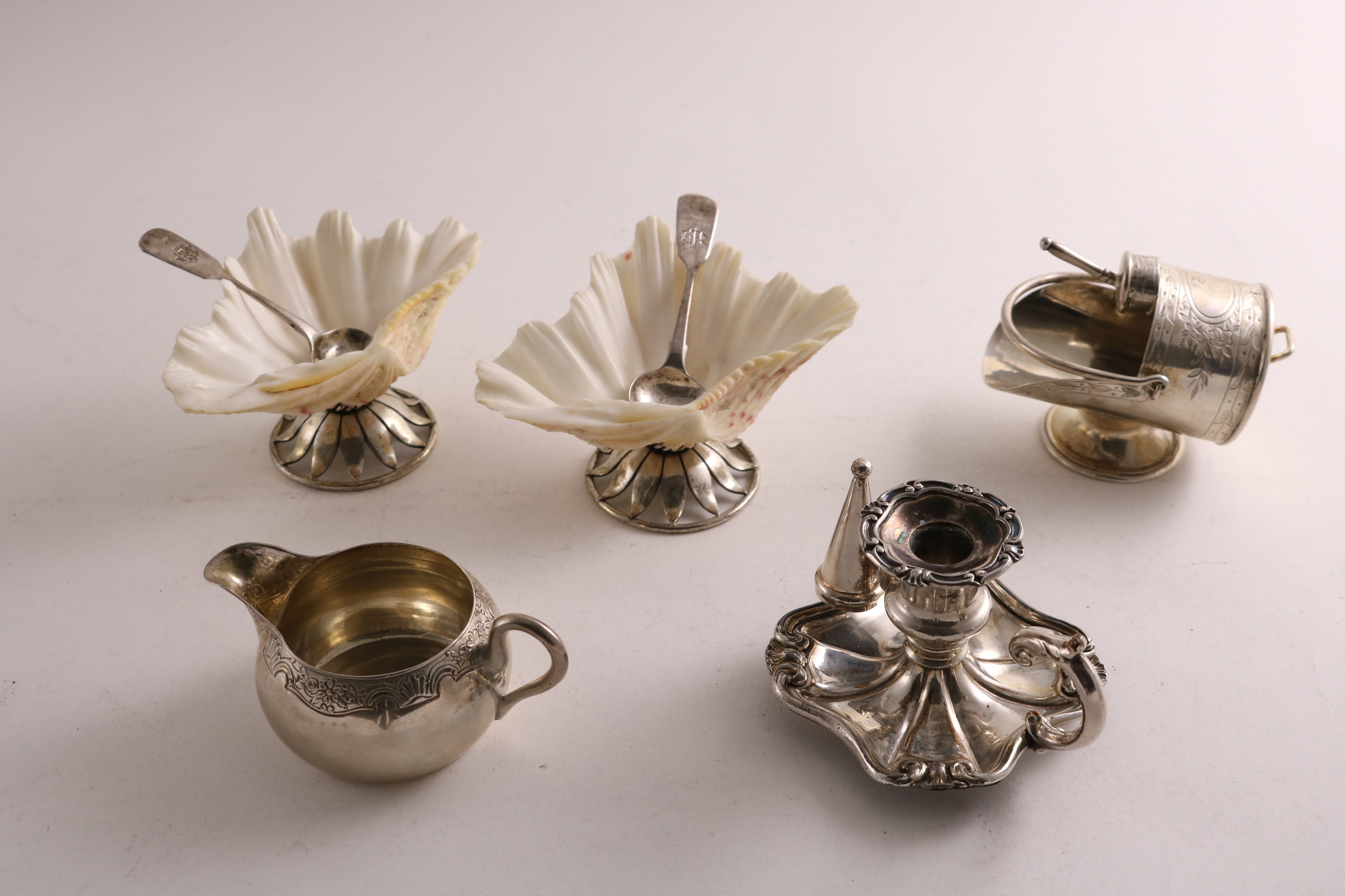 Lot 50 - A PAIR OF VICTORIAN SILVER-MOUNTED NATURAL SHELL SALTS probably by Walter Read, London 1868, a