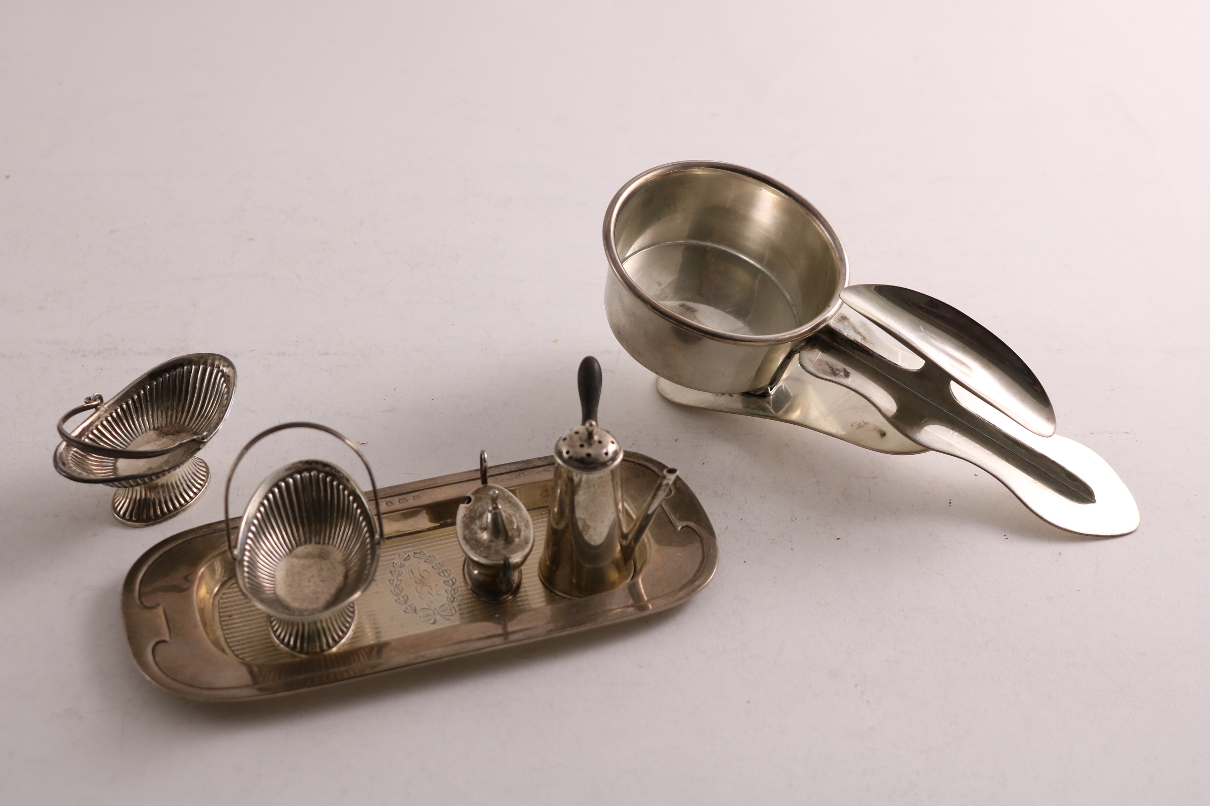 SILVER MINIATURES OR TOYS:- an Edwardian swing handled basket with part-fluting, by Levi &