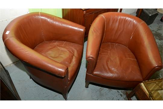 Pair of 1920/30s brown leather tub chairs on square tapering supports