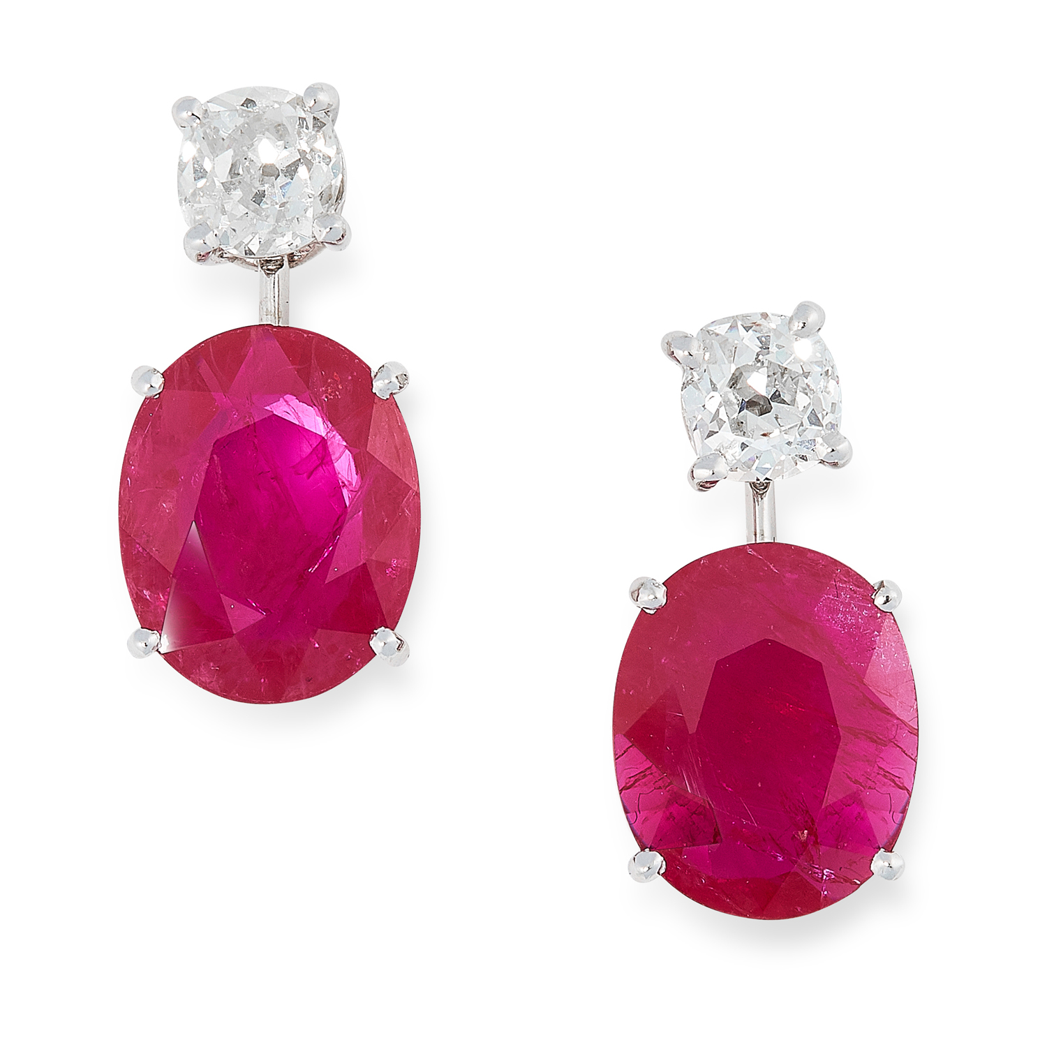 A PAIR OF RUBY AND DIAMOND EARRINGS in high carat white gold, each set with an oval cut ruby below a