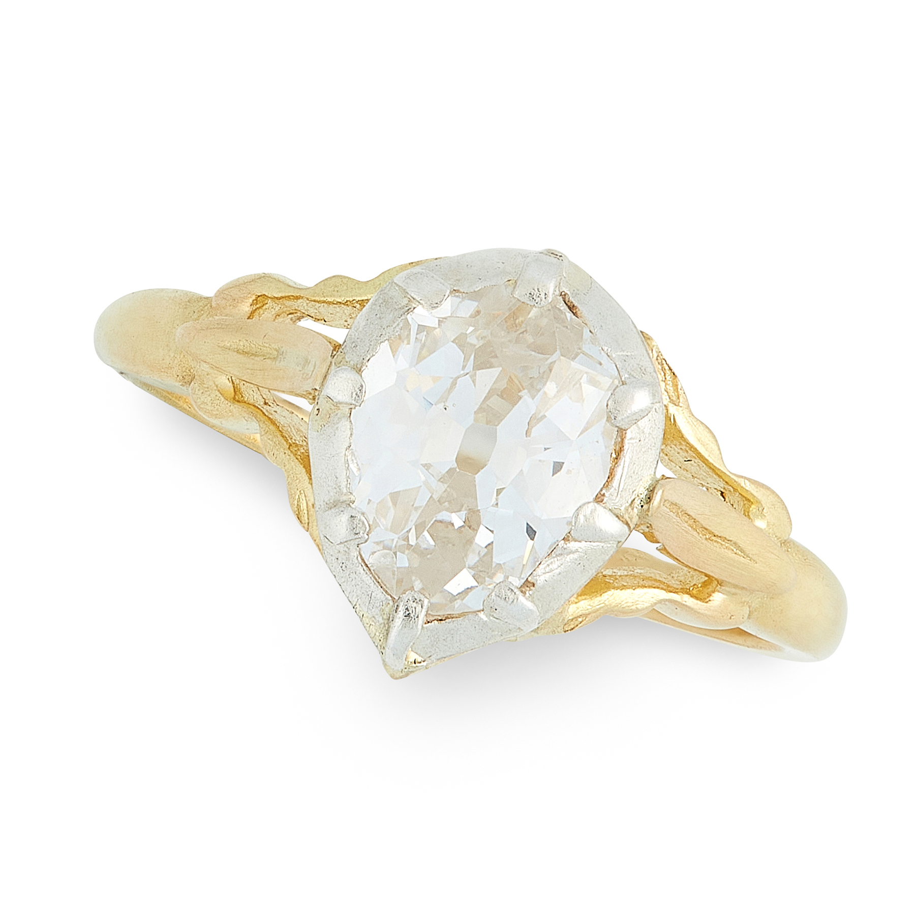 A DIAMOND DRESS RING in high carat yellow gold and silver, in the Georgian style, set with a pear