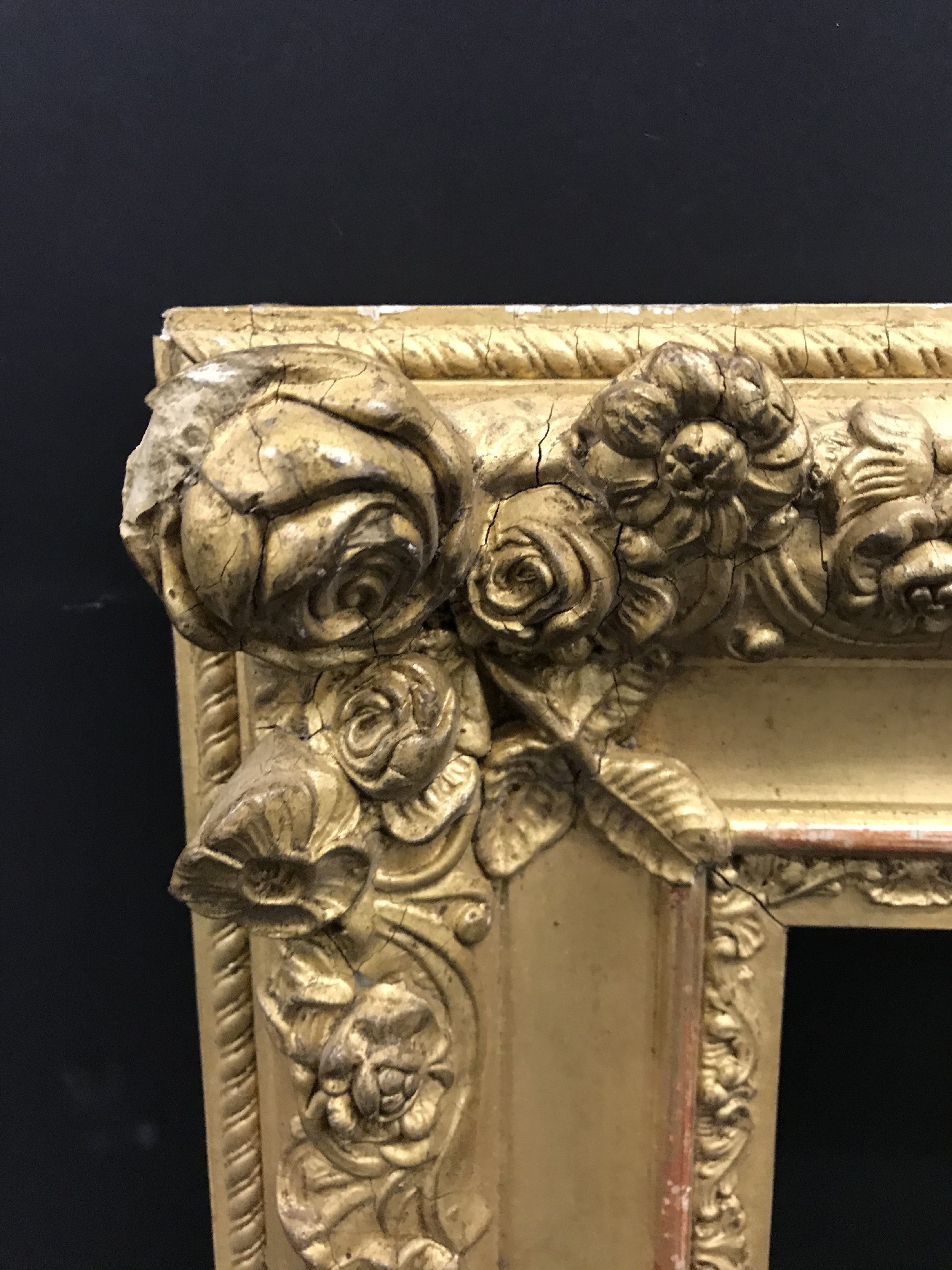 """Lot 3 - 19th Century French School. A Gilt Composition Frame, with floral corners, 24"""" x 19.5"""" (rebate), and"""