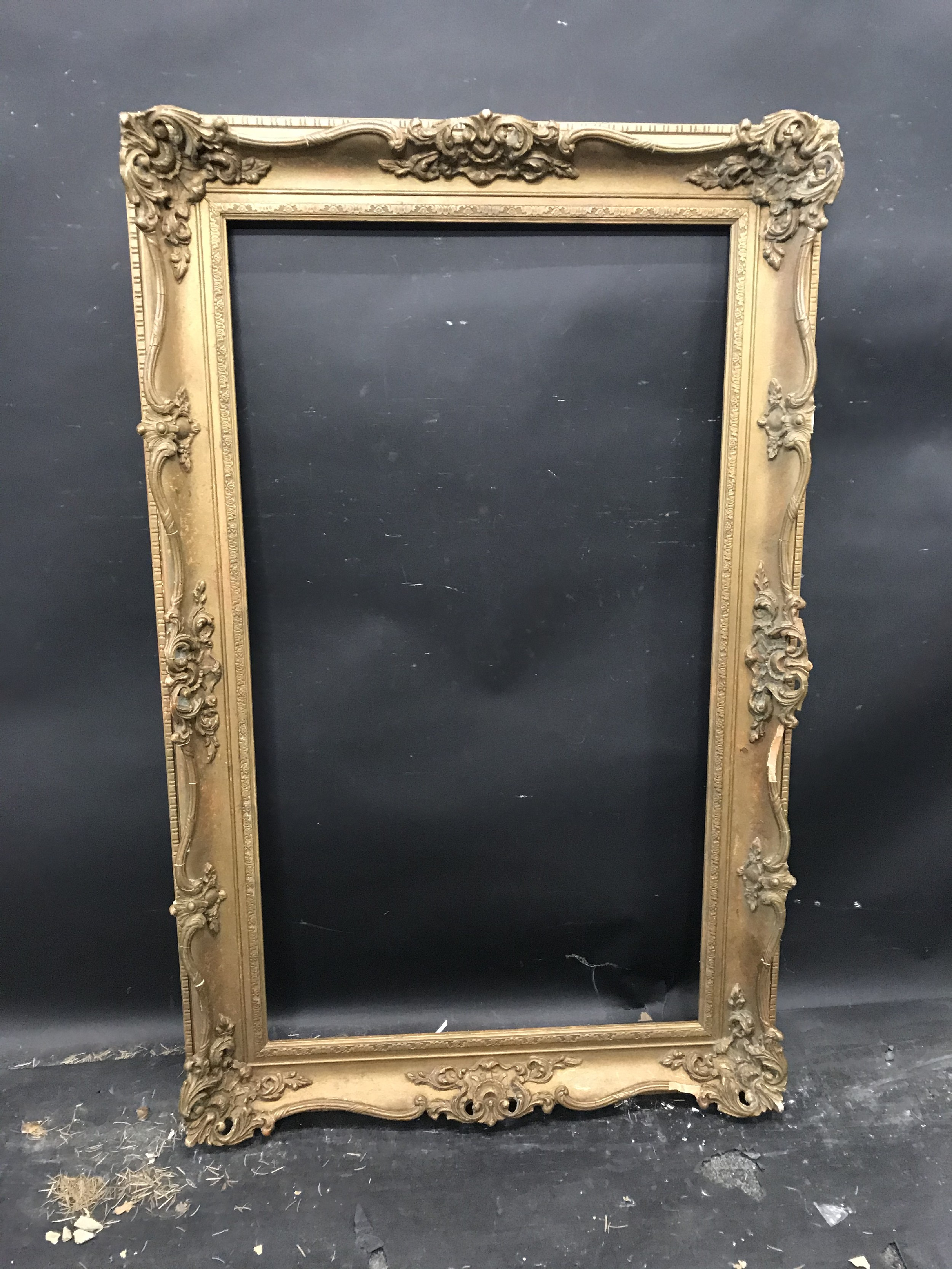 Lot 45 - 20th Century English School. A Gilt Composition Frame, with swept and pierced centres and corners,