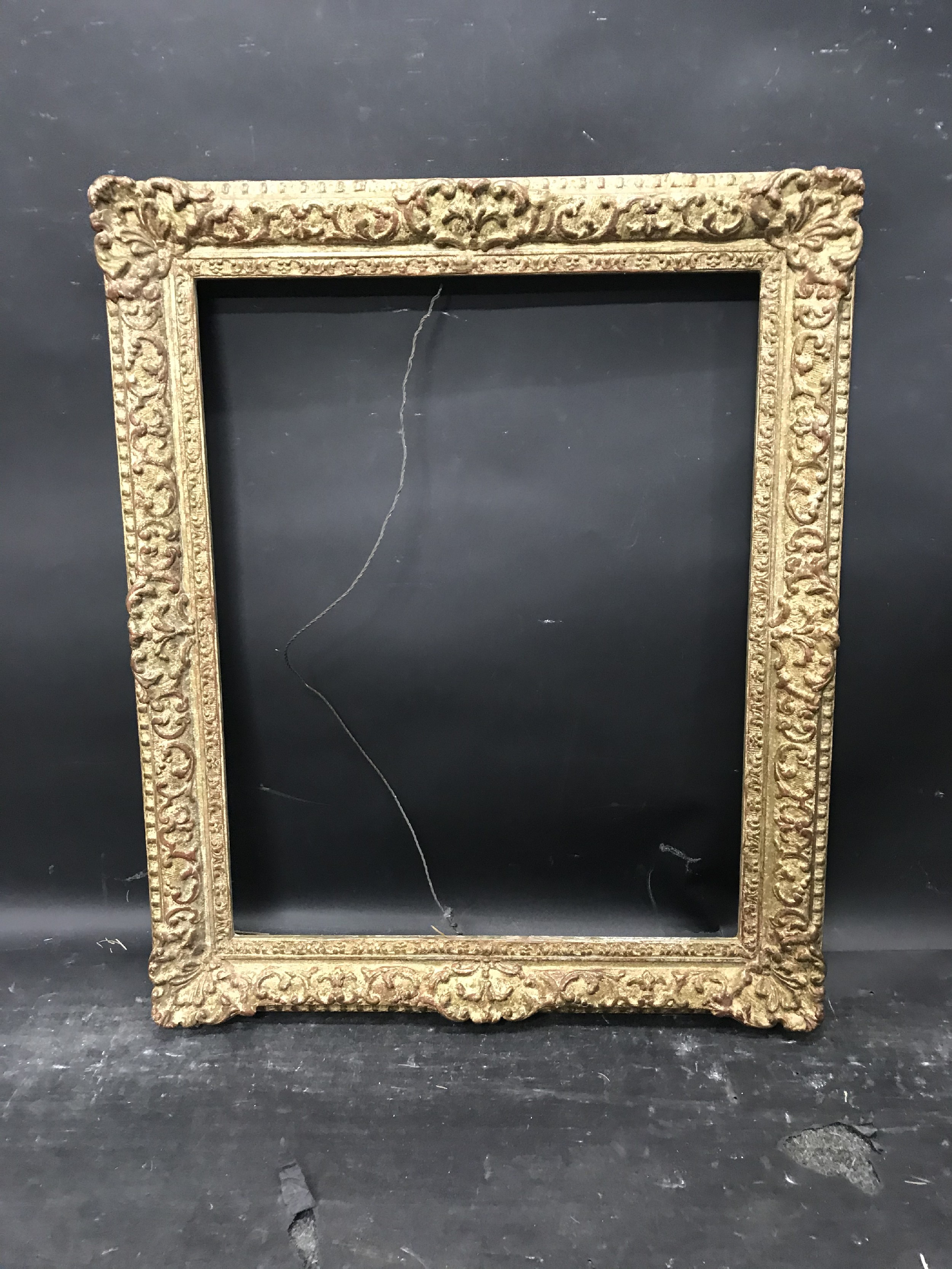 """Lot 37 - 20th Century English School. A Gilt Composition Frame, with swept centres and corners, 20"""" x 16"""" ("""