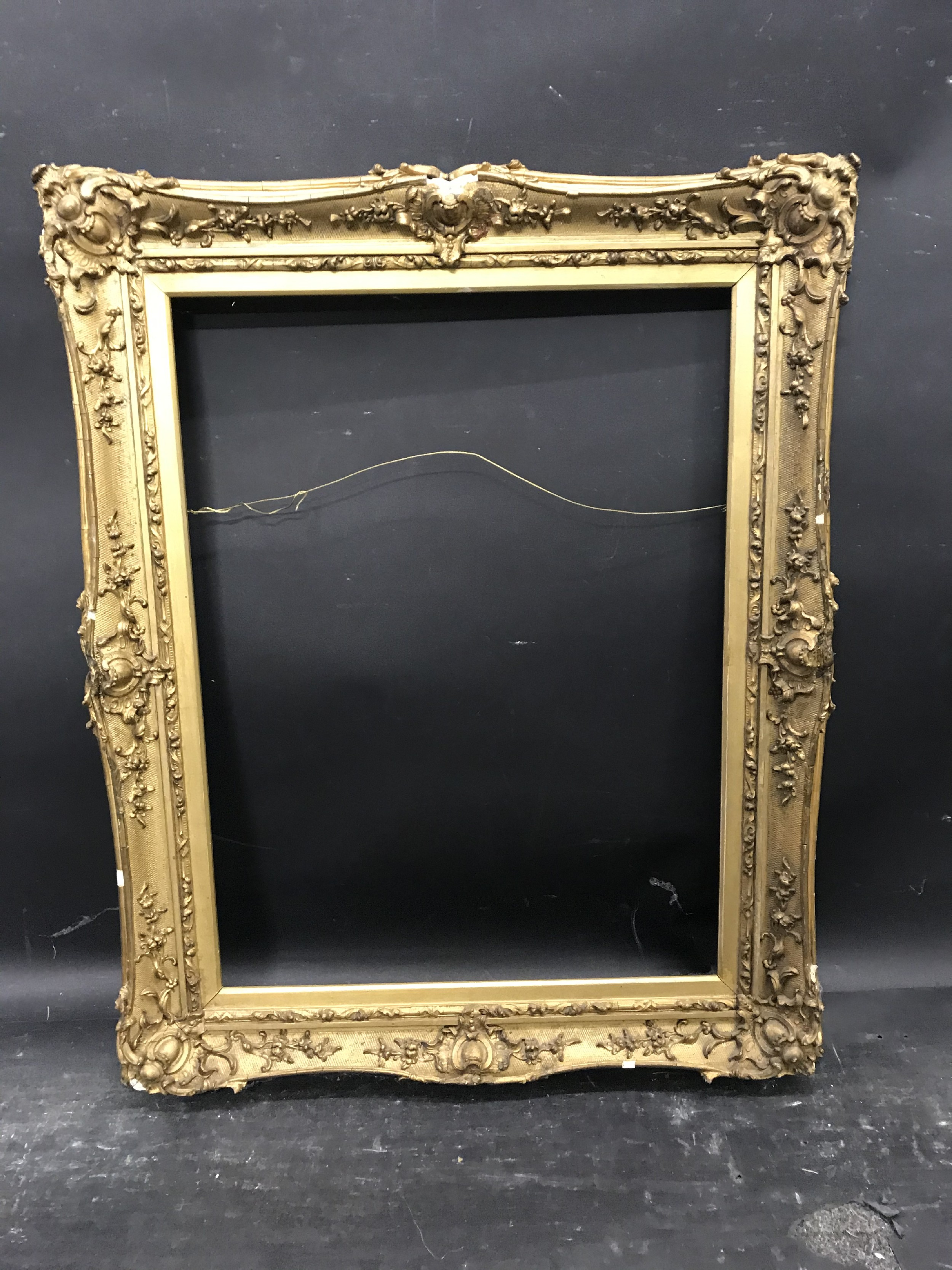 """Lot 31 - 19th Century English School. A Gilt Composition Frame, with swept centres and corners, 19"""" x 14."""