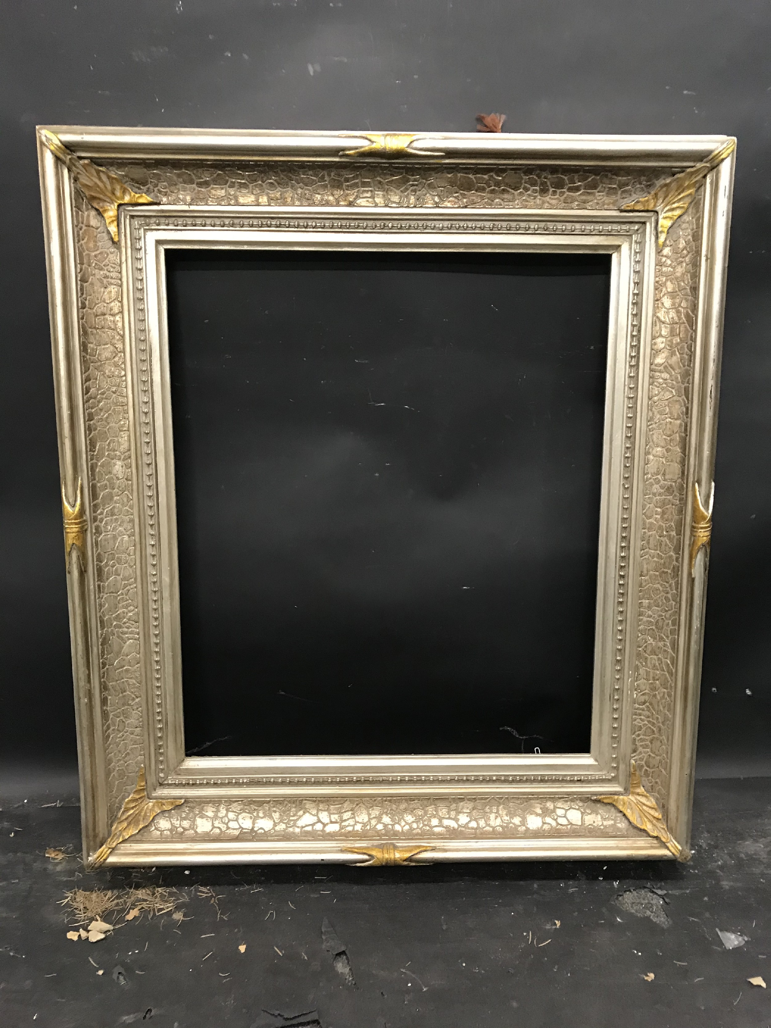 "Lot 52 - 20th Century American School. A Silver and Gilt Composition Frame, 24"" x 20"" (rebate)."