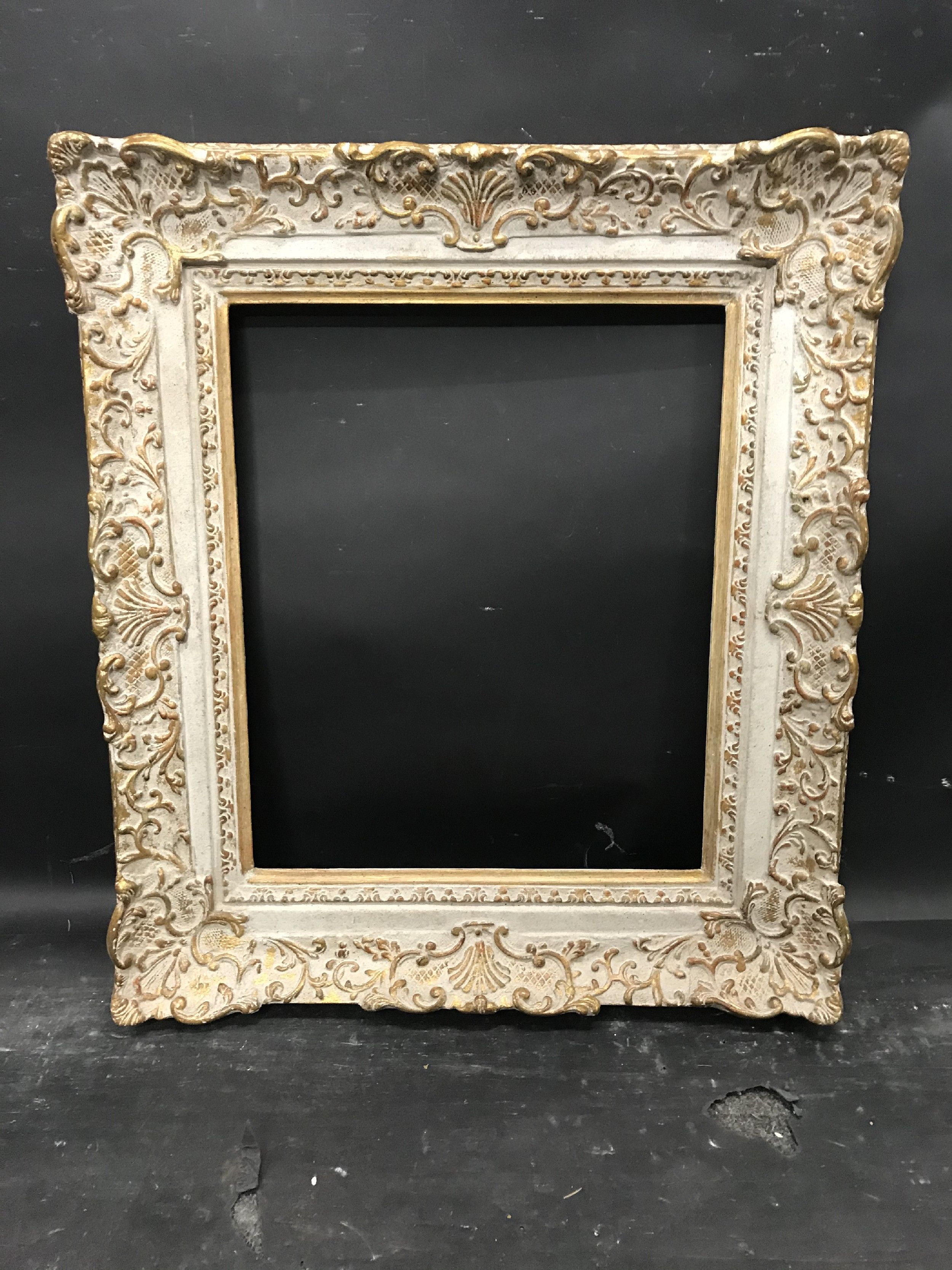 """Lot 33 - 20th Century English School. A Gilt and Painted Frame, with swept centres and corners, 18"""" x 15"""" ("""