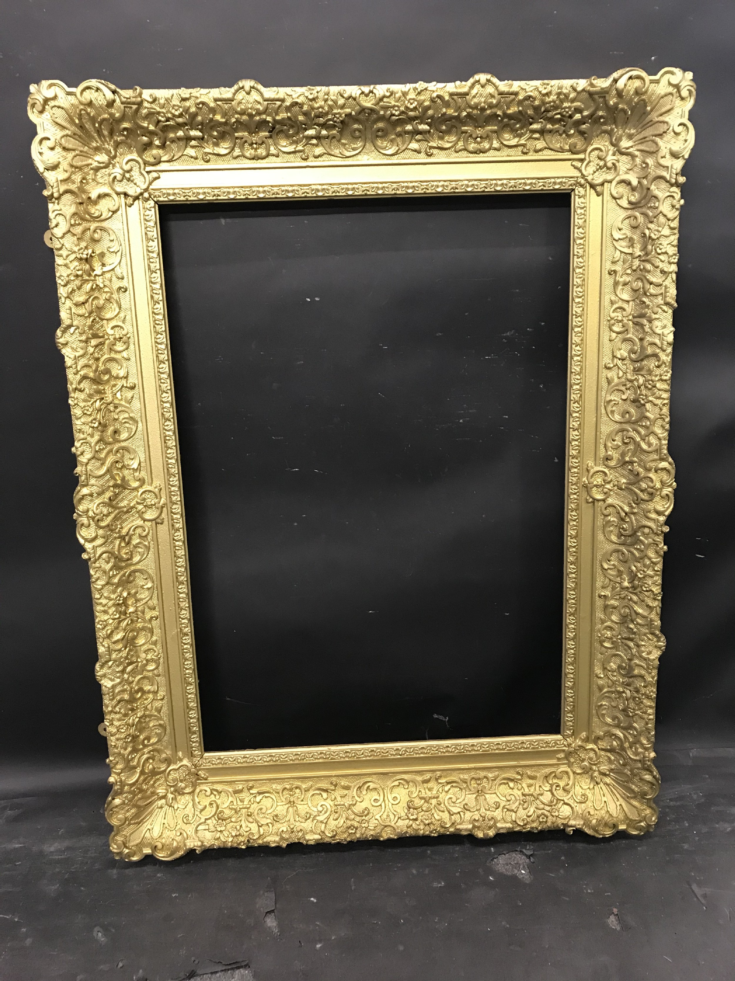 "Lot 11 - 19th Century English School. A Gilt Composition Frame, with swept centres and corners, 32"" x 22"" ("