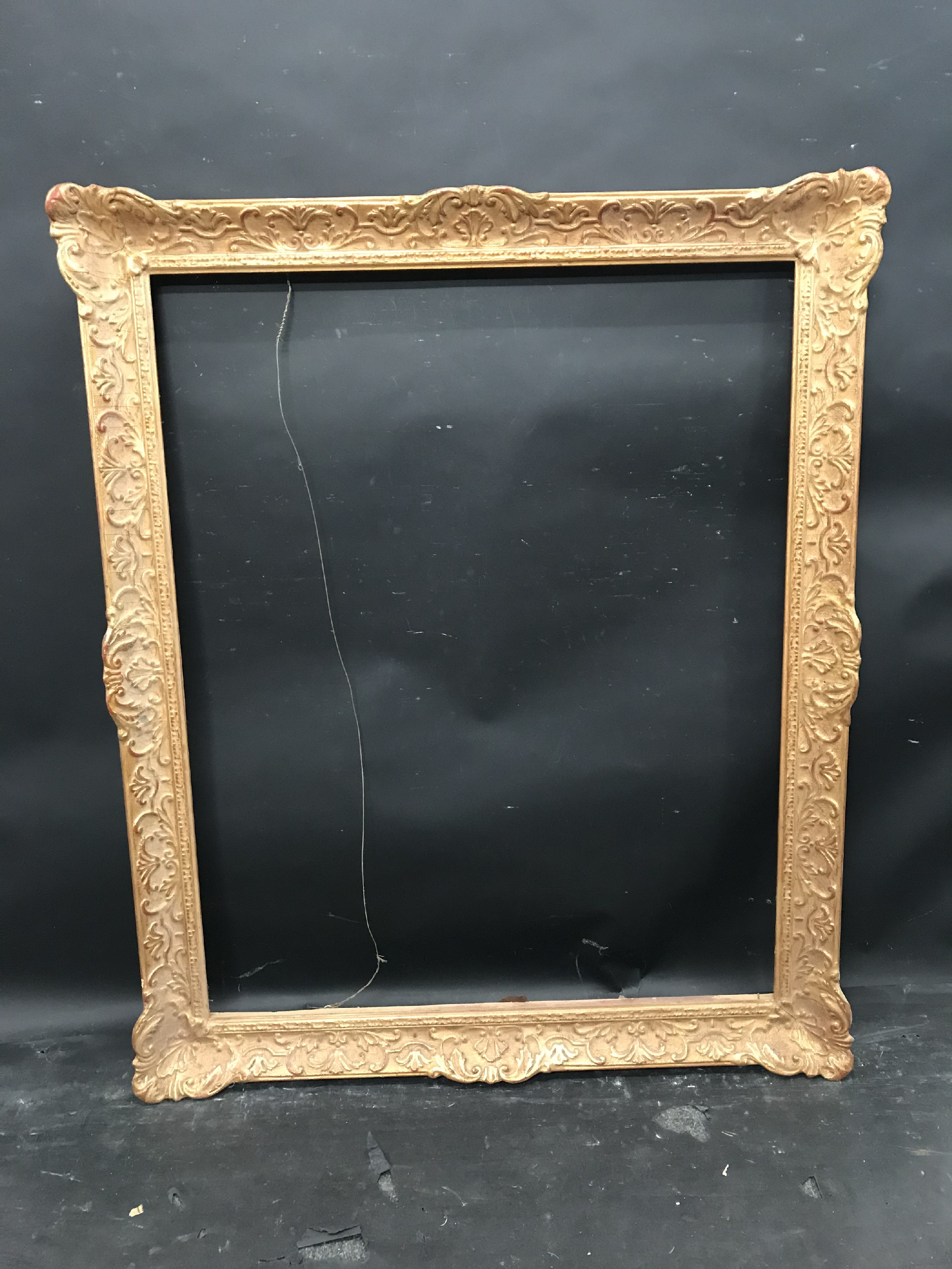 """Lot 49 - 20th Century European School. A Gilt Composition Frame, with swept centres and corners, 35.5"""" x 28."""