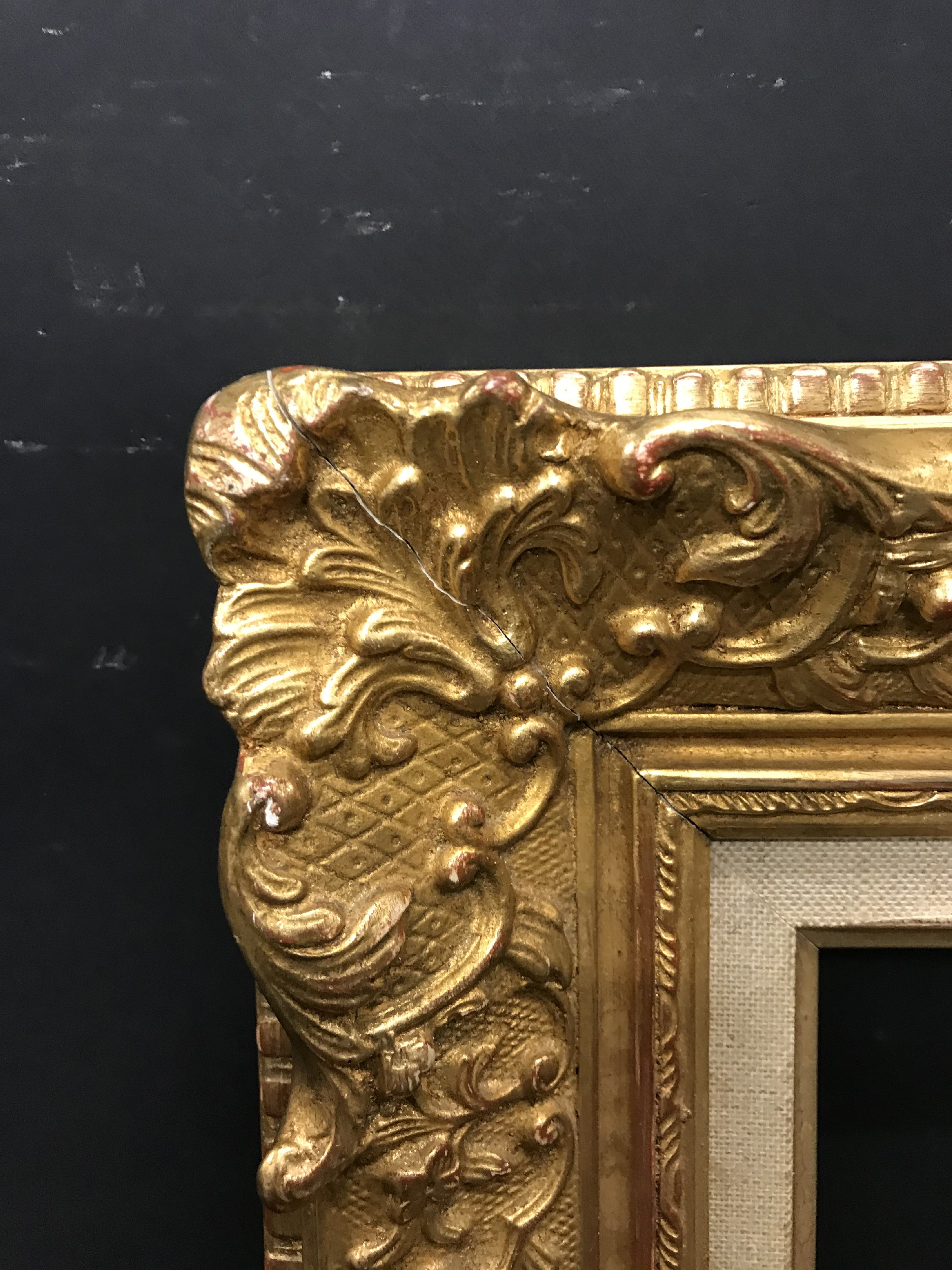 Lot 30 - 20th Century French School. A Gilt Composition Frame, with swept centres and corners, and a fabric