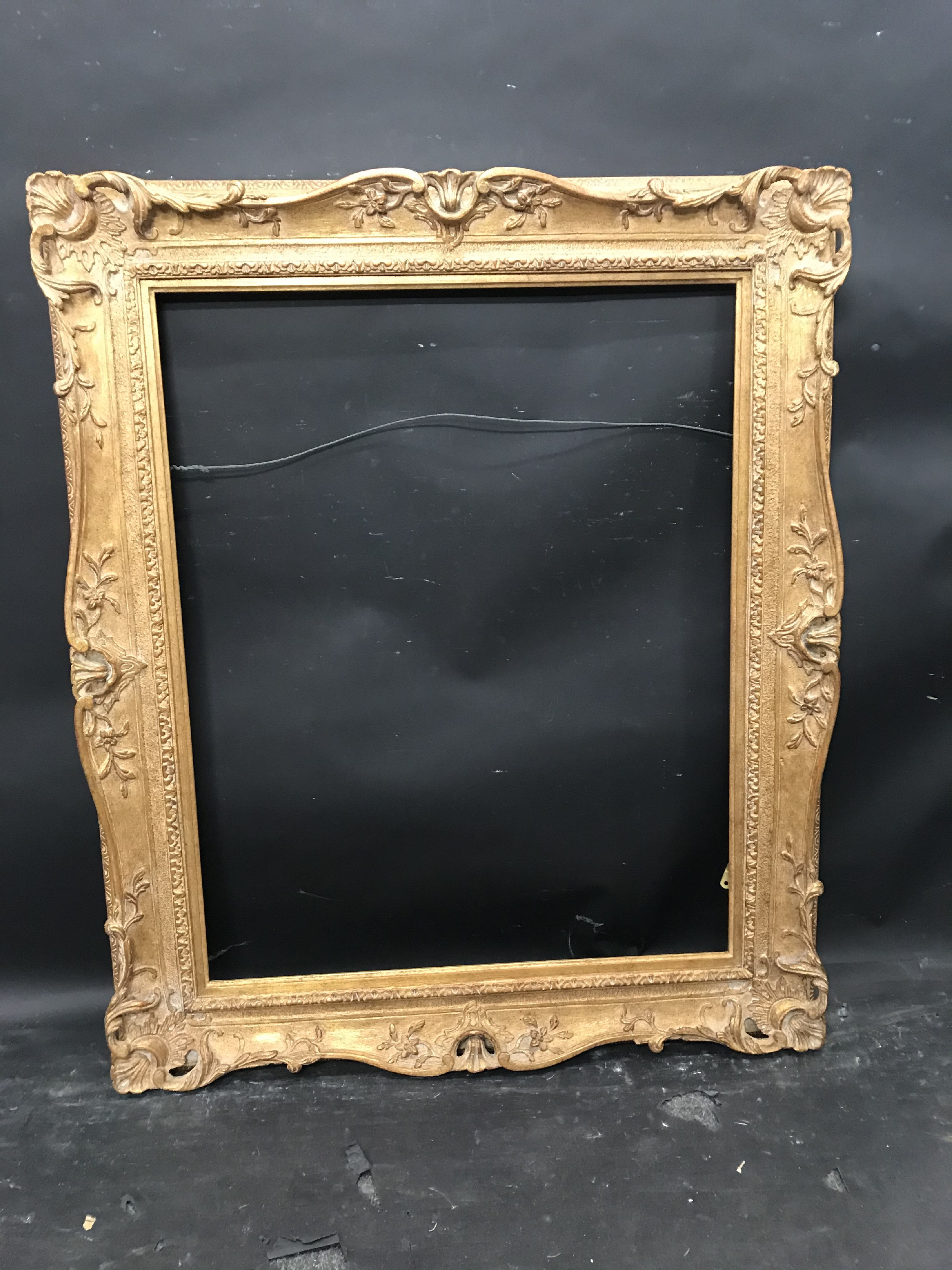 Lot 5 - 20th Century English School. A Gilt Composition Frame, with swept and pierced centres and corners,
