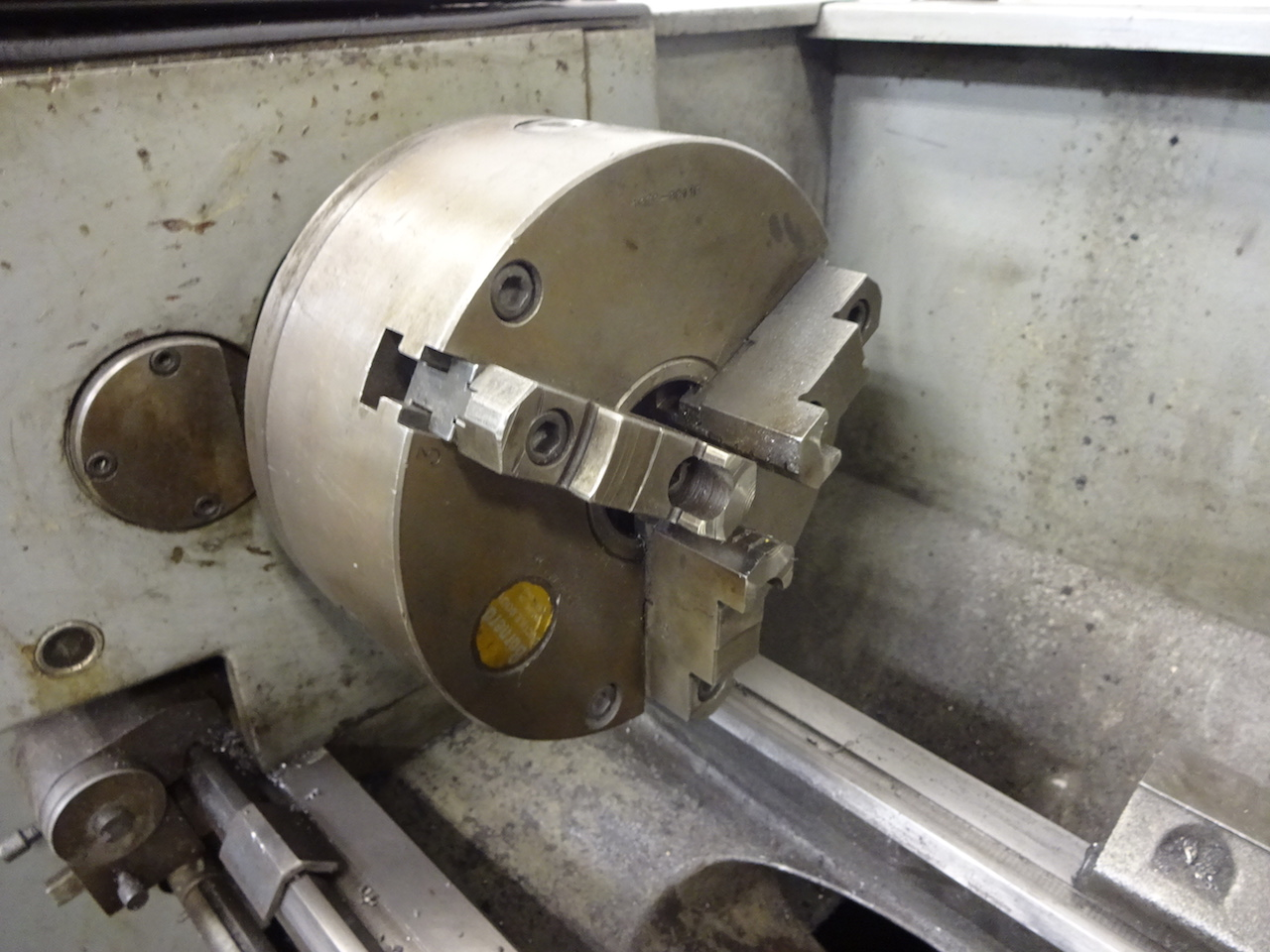 Lot 50 - Clausing 13 in. x 36 in. Model 1300 Engine Lathe, S/N 130559, 10 in. 4-Jaw Chuck, 8 in. 3-Jaw Chuck,