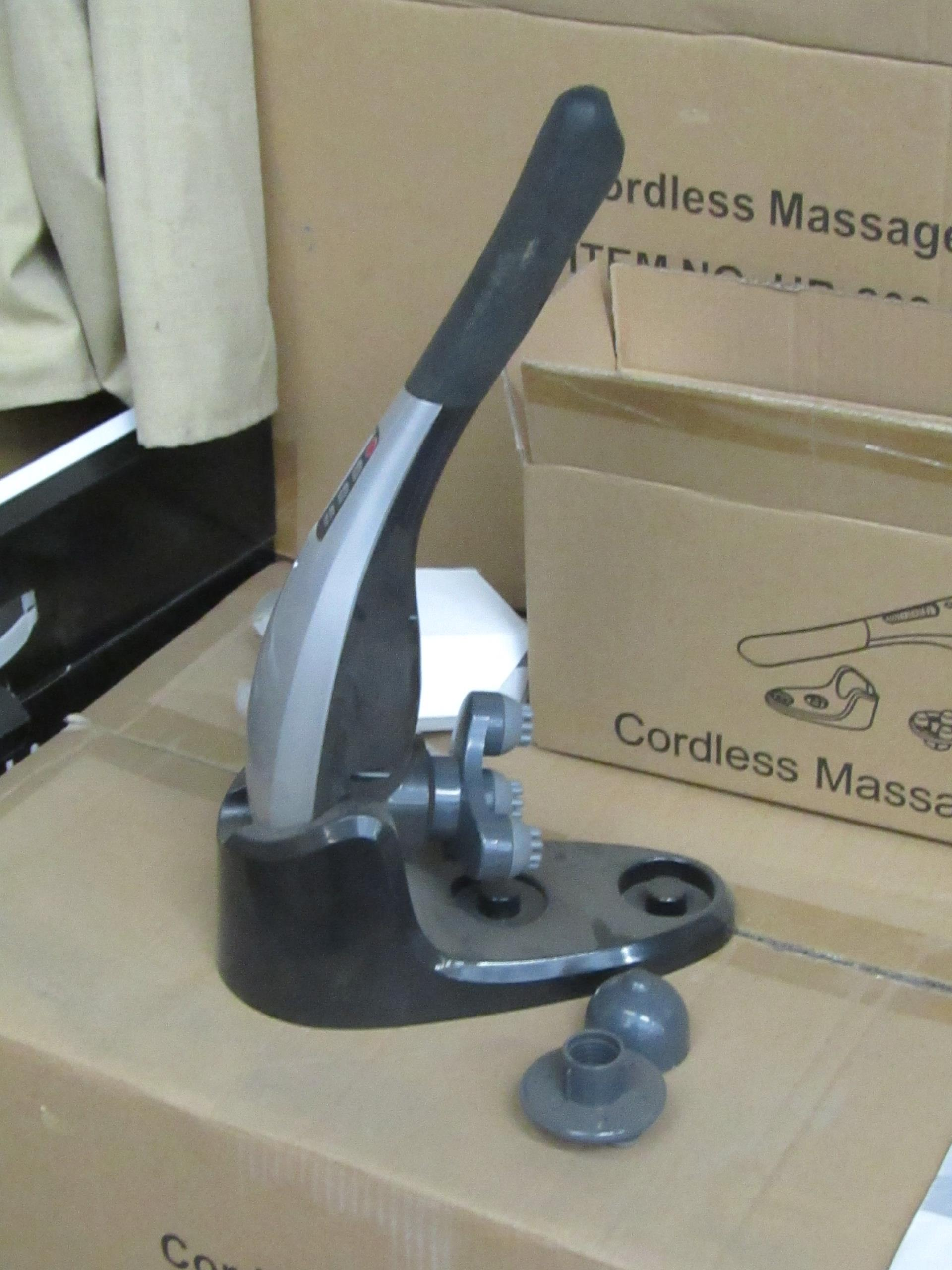 Lot 9 - Cordless handheld massage hammer with various head attachments. New & boxed.