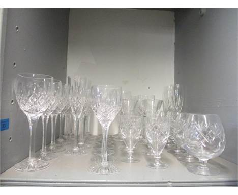A selection of cut table glass to include Stuart crystal, pair of Waterford Nocture champagne flutes and other drinking glass