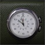 An Italian Pineider leather travel alarm clock, in box with dust bag, 8.5 x 7cm