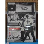 An exhibition poster, 'Nirvana- 1989-1993 A Retrospective', with signature in pen by photographer
