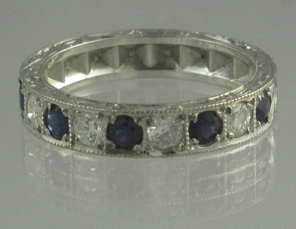 Lot 329 - AN 18CT WHITE GOLD SAPPHIRE AND DIAMOND
