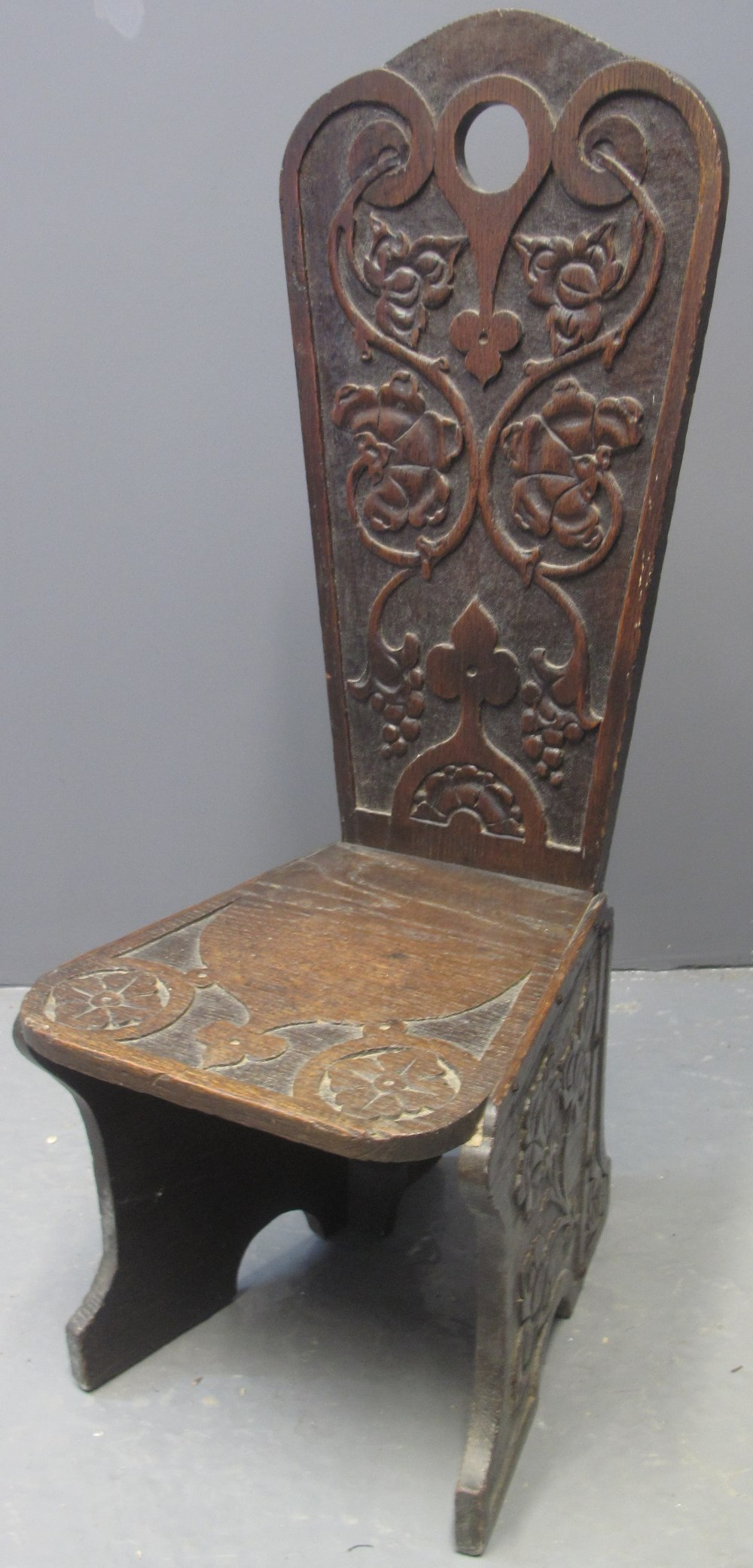 Lot 138 - 19TH CENTURY CARVED OAK GOTHIC DESIGN SPINNING CHAIR having tracery and flower head moulded
