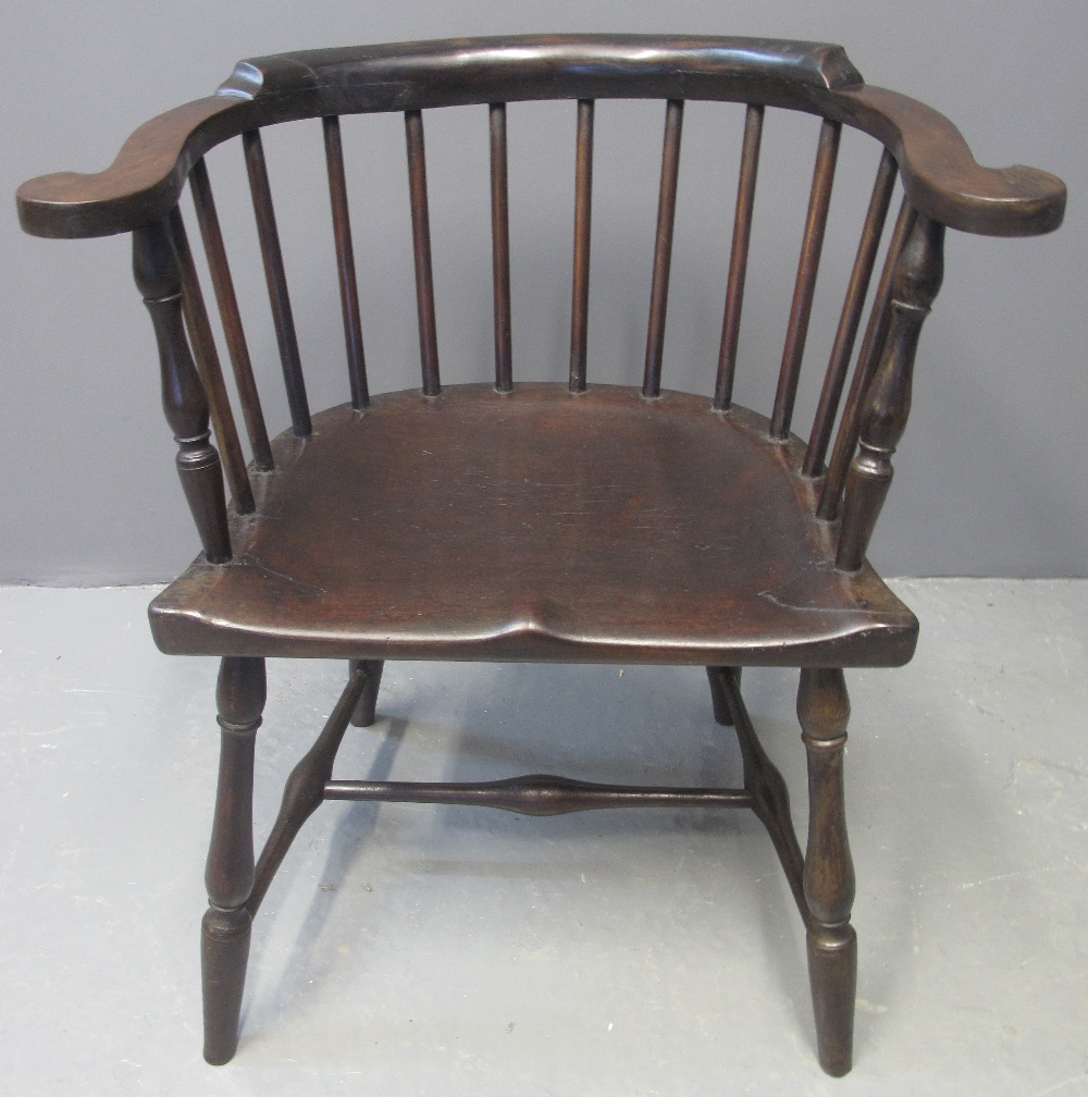 Lot 125 - 19TH CENTURY AMERICAN STICK BACKED ELBOW CHAIR in stained mixed woods with scrolled arms and