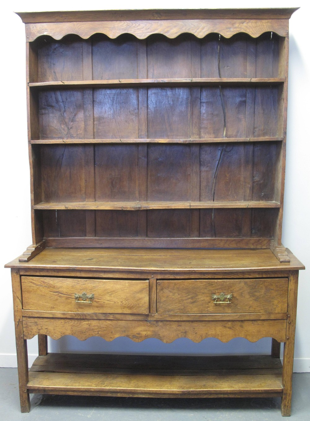 Lot 51 - 18TH CENTURY STYLE OAK POTBOARD DRESSER with boarded three shelf rack back over two deep drawers