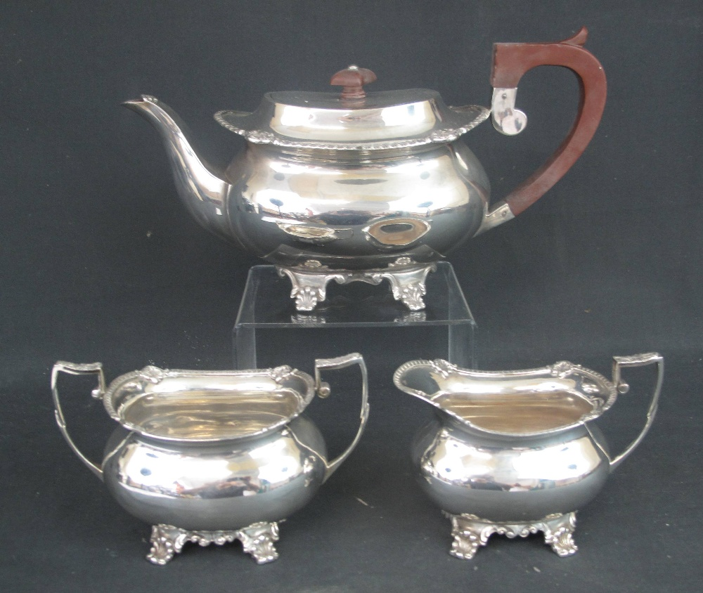 Lot 288 - MID 20TH CENTURY SILVER THREE PIECE TEA