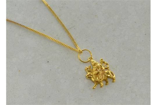 22ct yellow gold pendant depicting the hindu goddess durga on a 22ct yellow gold pendant depicting the hindu goddess durga on a yellow metal chain stamped 22ct mozeypictures Image collections